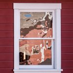 Abstract reflections of mountain sky and red mill at Kennecott