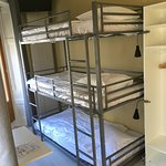 Triple bunk bed room, shower and washbasin in the room, WC in corridor