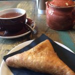 Pot of chai tea and beef samosa. Both delish! Americano coffee in the background. Recommend!