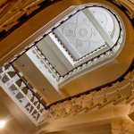 The view from the bottom of our grade two listed staircase looking up to the bespoke ceiling ros