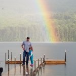 Father and daughter on our dock with beautiful rainbow