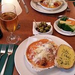 Lasagne, garlic bread, with different types of olives