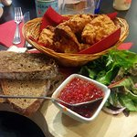 Pollock fish cakes, sweet chilli dipping sauce, dressed salad leaves and mixed breads.