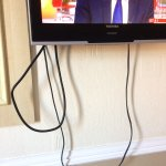 Tiny TV and dangling cables