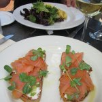 Smoked salmon on sourdough with goat cheese and celery