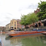 Punts Docked Along the River Cam