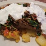 Mount Olympus meatloaf: topped w/ spinach, tomato, onion, chopped gyro meat & tzatziki sauce