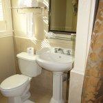 Large, spotless bathroom.