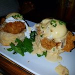 Chicken St. Charles - Fried chicken breast over buttermilk biscuit, topped with two poached eggs