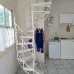 spiral staircase and kitchenette area in our room