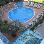 Shaped pool and sunbeds