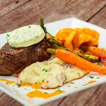 Surf and Turf special available on selected dates only: Sirloin topped with garlic herb butter