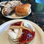 incredible pastries including the blueberry tart in foreground and almond croissant in back