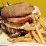 Venezulan beef burger with fries.  Taste the RAIN!