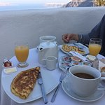Breakfast on our bedroom patio at Aroma Suites