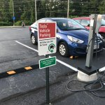 Tesla charging sign