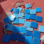 Loose tiles found at bottom of the pool.