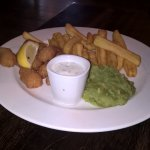 Scampi, frys,mushy peas and sauce.