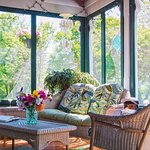 Relax on our lovely screened-in front porch.