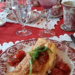 breakfast setup at the sunroom- main: goat cheese and chive omelette souffle with tomato jam