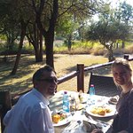 Enjoying a delicious lunch with a view of the waterhole in the background