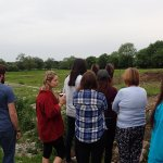 Gretta giving the college students a short tour of the farm