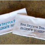 New Smyrna Beach tea towels are very popular with the longitude and latitude coordinates on them
