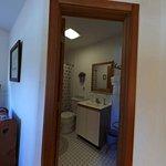 ceramic tiled bathrom with full tub/shower