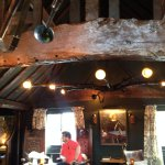 Great Tudor style wooden beams in the ceiling, strange paintings & oddities