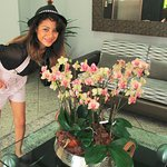 My daughter in the lobby that is decorated with beautiful orchids!