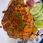 Khao Kai Jaew (also $11.90 AUD) An omelette sitting on a bed of rice.
