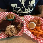 Smoked ribs, pulled pork, smoked brisket, sweet potato fries and hush puppies