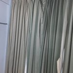 Torn Curtains with spider webs tangling in your hand while opening