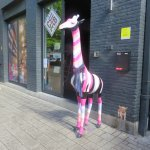 look for the giraffe greeter!
