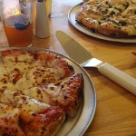 Canadian bacon with red sauce and pesto pizzas