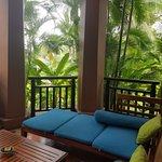 private sala overlooking hotel grounds in King Deluxe Tropical Pavilion