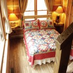 Our standard room has a full/queen bed, loft with 2 twins and private bath.
