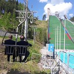 The best ski jump tower in the world.You can take a lift go up ski jump tower. Open air swimming