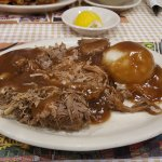 Roast beef with potatoes and gravy side