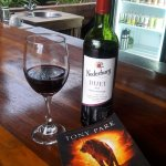 Good wine and a good book at the bar.