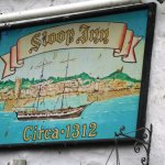 Guano splattered pub sign says it all