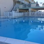 Nice heated pool and view of the 2nd floor deck. Tables and chairs as well as grills are availab