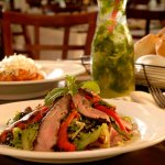 Great salad with seared NY steak. Carafes of mojjito make the day fresher.