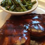 Barbecued chicken breast with green beans.
