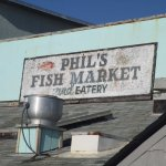 Phil's sign from beach behind restaurant