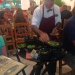 Staff making guacamole at the table!