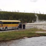 a tour group in an old yellowstone van