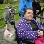 a happy customer enjoying one of the trips we offer;  a day out to Blackpool Zoo.
