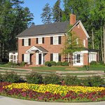 The Graham Family Homeplace was rebuilt brick-by-brick on the Library grounds and is open to tou