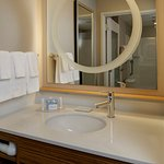 Guest bathrooms in our suites provide well-lit vanity areas and complimentary bath products.